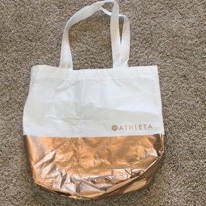 Gold white ATHLETA bag